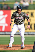 Arkansas Travelers catcher Jett Bandy (27) leads off second during a game against the San Antonio Missions on May 25, 2014 at Dickey-Stephens Park in Little Rock, Arkansas.  Arkansas defeated San Antonio 3-1.  (Mike Janes/Four Seam Images)