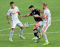 WASHINGTON, DC - SEPTEMBER 12: Junior Moreno #5 of D.C. United fights for the ball with Daniel Royer #77 of the New York Red Bulls during a game between New York Red Bulls and D.C. United at Audi Field on September 12, 2020 in Washington, DC.