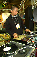 World Famous DJ Jojo Flores, A Montreal of Filipino origin spins at the NSIA 2002 trade show held  at Place Bonaventure<br /> <br /> <br /> photo : (c)  Images Distribution