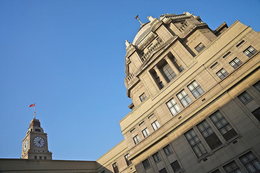 Through A Twist Of Perspective, The Bank Appears To Overwhelm The Clock Tower Of The Shanghai Custom House.