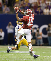 Darius Hanks of Alabama catches a pass away from Tyrann Mathieu of LSU during BCS National Championship game at Mercedes-Benz Superdome in New Orleans, Louisiana on January 9th, 2012.   Alabama defeated LSU, 21-0.