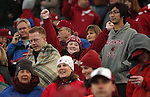 Happy Washington State fans celebrate the Cougars overtime victory in the 2008 Apple Cup over arch-rival Washington, 16-13.