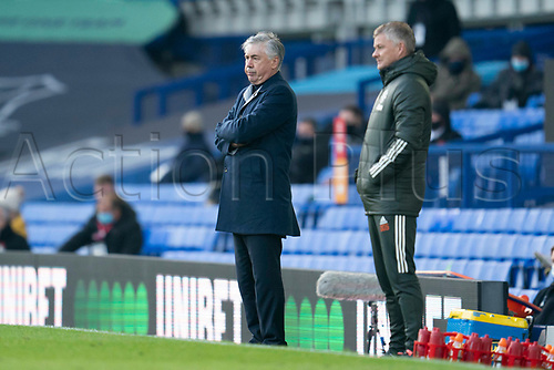 7th November 2020; Liverpool, England;  Evertons manager Carlo Ancelotti stands alongside Manchester Uniteds manager Ole Gunnar Solskjaer during the Premier League match between Everton and Manchester United at Goodison Park