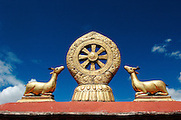 The decoration on the rooftop of the 7th century Jokhang temple in Lhasa, Tibet. Jokhang Temple is Tibet's most sacred place of worship. .27 Jul 2006