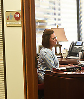 Jacki Gustin, human resources administrative assistants, talks with a newly hired teacher on Wednesday July 14 2021 at the Rogers school administration building.<br />(NWA Democrat-Gazette/Flip Putthoff)