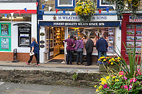 UK, England, Pateley Bridge, Yorkshire.  Butcher Shop and ATM Machine seen from the Village Square.