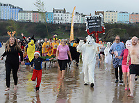 Pictured: People in fancy dress take to the sea in Tenby. Thursday 26 December 2019<br /> Re: Hundreds of people have taken part in this year's Boxing Day Swim in Tenby, Wales, UK.