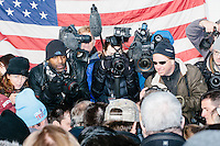Journalists, including Keith Bedford of the Boston Globe (left, with scarf), Reuters' Brian Snyder (brown jacket), and freelancer Ryan McBride (right with gray hat), photograph the scene as Texas senator and Republican presidential candidate Ted Cruz greets people after speaking at a Second Amendment Rally outside Granite State Indoor Range in Hudson, New Hampshire.