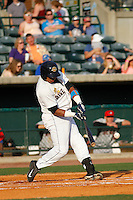 Charleston RiverDogs catcher Isaias Tejada (19) at bat during a game against the Hickory Crawdads at Joseph P. Riley Jr. Ballpark on May 2, 2015 in Charleston, South Carolina. Hickory defeated Charleston  4-1. (Robert Gurganus/Four Seam Images)