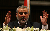 "Hamas leader Ismail Haniyeh, prime minister of the Palestinian government dismissed by President Mahmoud Abbas, gives a speech in Gaza June 24, 2007. Haniyeh dismissed Israel's decision on Sunday to release Palestinian tax funds as bribery and said ""resistance"" was the only way forward.""photo by Fady Adwan"""