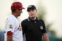 Umpire Scott Costello talks with coach Erik Pappas (12) during a game between the Frisco RoughRiders and Springfield Cardinals on June 4, 2015 at Hammons Field in Springfield, Missouri.  Frisco defeated Springfield 8-7.  (Mike Janes/Four Seam Images)