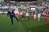 Pictured: Cyril and Cybil the swans with Club ambassador Lee Trundle and children mascots. Saturday 23 August 2014<br /> Re: Premier League, Swansea City FC v Burnley at the Liberty Stadium, south Wales