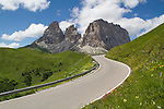 Road and Sassolungo rock formation, Dolomite Mountains, Canazei, Italy,