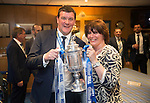 St Johnstone v Dundee United....17.05.14   William Hill Scottish Cup Final<br /> Manager Tommy Wright pictured with his wife Ann and the Scottish Cup in the boardroom back at McDiarmid Park<br /> Picture by Graeme Hart.<br /> Copyright Perthshire Picture Agency<br /> Tel: 01738 623350  Mobile: 07990 594431