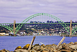 Yaquina Bay Bridge, U.S. Highway 101, Pacific Coast Scenic Byway, in Newport, Oregon.  View from south jetty of Yaquina Bay.  Oregon Central Coast, beaches, bays, bars, family fun, winter storms, lighthouses, fishing boats, bluffs, fossils and beach walks.