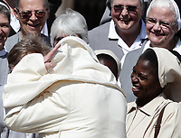 Papa Francesco saluta un gruppo di suore al termine dell'udienza generale del mercoledi' in Piazza San Pietro, Citta' del Vaticano 11 settembre 2019.<br /> Pope Francis greets nuns at the end of the weekly general audience in St. Peter's Square at the Vatican,  on September 11, 2019.<br /> UPDATE IMAGES PRESS/Isabella Bonotto<br /> <br /> STRICTLY ONLY FOR EDITORIAL USE