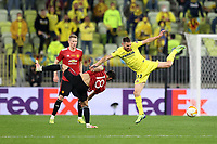 26th May 2021; STADION GDANSK GDANSK, POLAND; UEFA EUROPA LEAGUE FINAL, Villarreal CF versus Manchester United:  Manchester United's BRUNO FERNANDES challenges MOI GOMEZ
