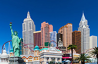 New York, New York Casino and the Lady Liberty statue under a beautiful blue sky in Las Vegas Strip, Nevada