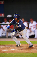 New Hampshire Fisher Cats catcher Wilkin Castillo (14) lays down a bunt during a game against the Harrisburg Senators on June 2, 2016 at FNB Field in Harrisburg, Pennsylvania.  New Hampshire defeated Harrisburg 2-1.  (Mike Janes/Four Seam Images)