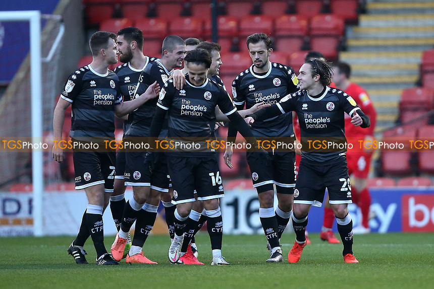 Sam Matthews of Crawley Town (20) scores the first goal for his team and celebrates with his team mates during Leyton Orient vs Crawley Town, Sky Bet EFL League 2 Football at The Breyer Group Stadium on 19th December 2020