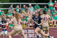 NEWTON, MA - MAY 22: Hannah Dorney #22 of Notre Dame on the attack during NCAA Division I Women's Lacrosse Tournament quarterfinal round game between Notre Dame and Boston College at Newton Campus Lacrosse Field on May 22, 2021 in Newton, Massachusetts.
