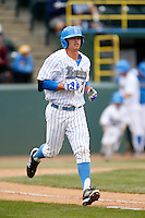 Kevin Kramer #7 of the UCLA Bruins runs to first base during a baseball game against the Washington Huskies at Jackie Robinson Stadium on March 17, 2013 in Los Angeles, California. (Larry Goren/Four Seam Images)