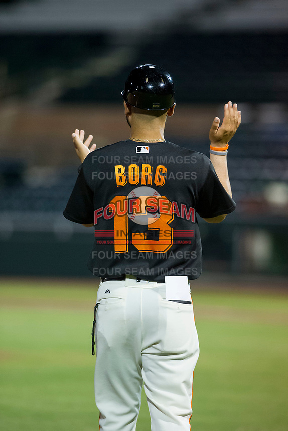 AZL Giants manager Hector Borg (13) coaches third base against the AZL Rangers on August 22 at Scottsdale Stadium in Scottsdale, Arizona. AZL Rangers defeated the AZL Giants 7-5. (Zachary Lucy/Four Seam Images via AP Images)