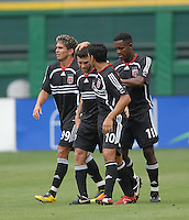 DC United midfielder Ben Olsen (14) celebrates with teammates Jaime Moreno (99), Christian Gomez (10) and Luciano Emilio (11) after his second goal of the game. Ben Olsen scored the first hat trick of his career against the NY Red Bulls. DC United defeated the New York Red Bulls, 4-2, at RFK Stadium in Washington DC, Sunday, June 10 , 2007.