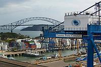 aerial photograph of the Panama Ports Company crane, tug, boats and container storagte, Port of Balboa, at the entrance to the Panama Canal, Panama; the Bridge of the Americas is in the background | fotografía aérea de la grúa, remolcador, barcos y almacén de contenedores de la Panama Ports Company, Puerto de Balboa, a la entrada del Canal de Panamá, Panamá; el Puente de las Américas está al fondo