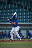 AZL Cubs catcher Henderson Perez (8) at bat during an Arizona League game against the AZL Brewers at Sloan Park on June 29, 2018 in Mesa, Arizona. The AZL Cubs 1 defeated the AZL Brewers 7-1. (Zachary Lucy/Four Seam Images)