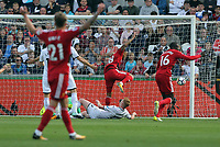 Andre Gray of Watford (C) scores the opening goal during the Premier League match between Swansea City and Watford at The Liberty Stadium, Swansea, Wales, UK. Saturday 23 September 2017