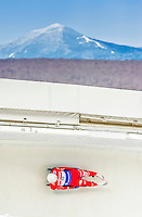 5 December 2014: Emanuel Rieder, sliding for Italy, slides through Curve Number 14 on his first run, ending the day with a 12th place finish and a combined 2-run time of 1:43.666 in the Men's Competition at the Viessmann Luge World Cup, at the Olympic Sports Track in Lake Placid, New York, USA. Mandatory Credit: Ed Wolfstein Photo *** RAW (NEF) Image File Available ***