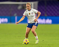 ORLANDO, FL - JANUARY 18: Lindsey Horan #9 of the USWNT passes the ball during a game between Colombia and USWNT at Exploria Stadium on January 18, 2021 in Orlando, Florida.