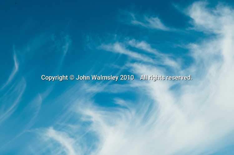 High cirrus clouds in strong winds.