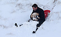 13/01/17<br />  <br /> Leum Shoebridge sledges in deep snow with his dog Ted near the Cat and Fiddle between Macclesfield and Buxton in the Peak District.<br /> <br /> <br /> All Rights Reserved F Stop Press Ltd. (0)1773 550665   www.fstoppress.com