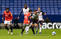 Bolton Wanderers' Antoni Sarcevic (right) competing with Salford City's Jason Lowe<br /> <br /> Photographer Andrew Kearns/CameraSport<br /> <br /> The EFL Sky Bet League Two - Bolton Wanderers v Salford City - Friday 13th November 2020 - University of Bolton Stadium - Bolton<br /> <br /> World Copyright © 2020 CameraSport. All rights reserved. 43 Linden Ave. Countesthorpe. Leicester. England. LE8 5PG - Tel: +44 (0) 116 277 4147 - admin@camerasport.com - www.camerasport.com