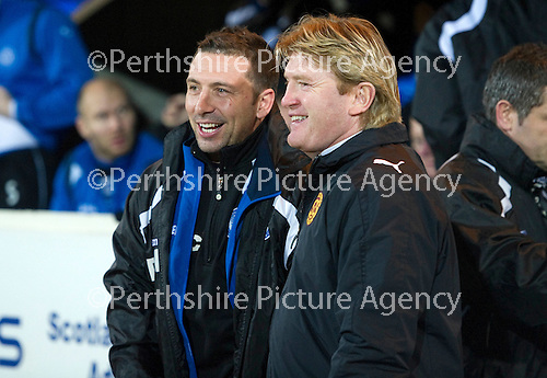 St Johnstone v Motherwell....26.01.11  .Derek McInnes greets Stuart McCall.Picture by Graeme Hart..Copyright Perthshire Picture Agency.Tel: 01738 623350  Mobile: 07990 594431