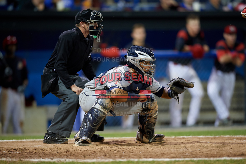 Mahoning Valley Scrappers catcher Gian Paul Gonzalez (4) and home plate umpire Evin Johnson during a game against the Batavia Muckdogs on August 16, 2017 at Dwyer Stadium in Batavia, New York.  Batavia defeated Mahoning Valley 10-6.  (Mike Janes/Four Seam Images)