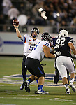 Boise State quarterback Grant Hedrick (9) passes against Nevada in the second half of an NCAA college football game in Reno, Nev., on Saturday, Oct. 4, 2014. Boise State's Travis Averill (73) and Nevada's Jordan Hanson (92) are at right. Boise State won 51-46. (AP Photo/Cathleen Allison)