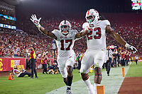 LOS ANGELES, CA - SEPTEMBER 11: Kyu Blu Kelly #17 of the Stanford Cardinal reacts to his pick-6 with Ryan Johnson #23 during a game between University of Southern California and Stanford Football at Los Angeles Memorial Coliseum on September 11, 2021 in Los Angeles, California.