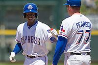 Round Rock shortstop Jurickson Profar (10) smiles after getting a hit against the Nashville Sounds in the Pacific Coast League baseball game on May 5, 2013 at the Dell Diamond in Round Rock, Texas. Round Rock defeated Nashville 5-1. (Andrew Woolley/Four Seam Images).