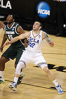 UCLA Bruins forward Reeves Nelson #22 looks for a rebound while battling Michigan State Spartans center Derrick Nix #25 during the second round game of the NCAA Basketball Tournament at St. Pete Times Forum on March 17, 2011 in Tampa, Florida.  UCLA defeated Michigan State 78-76.  (Mike Janes/Four Seam Images)