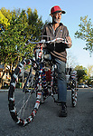 Richard Perry check out his new tricycle outside The Station on W. 11th in the Heights Tuesday March 24, 2015. The bike was donated by neighbors after his last bike was stolen.(Dave Rossman photo)