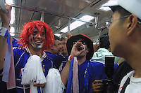 """Frecnch national team supporters, nicknamed """"Les Blues"""", chant """"We are the champions, We are the World Champions"""" in French while on the subway from the Itaewon district to the Seoul World Cup Stadium before the opening day match between France and Senagal on Friday May 31st, 2002 in Seoul, South Korea."""