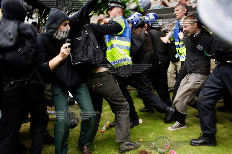 Black Bloc protestors collide with the police at the Carnival of Full Enjoyment demonstration in Edinburgh, an event linked to the G8 summit.