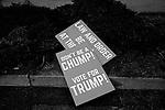 "MIDDLETOWN, PA — SEPTEMBER 26, 2020:  A sign reads ""don't be a chump, vote for Trump!"" at a rally for President Donald Trump during the Covid-19 pandemic at the Harrisburg International Airport on September 25, 2020 in Middletown, PA.  Thousands of attendees, most of whom were maskless, rode on shuttle busses to and from the long term parking lot and the event site— as the world nears one million Covid-19 deaths— defying the states ban on gatherings over 250 people.  Photograph by Michael Nagle"