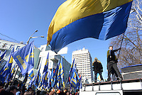 A protester waives a huge Ukrainian flag. Kiev, Ukraine
