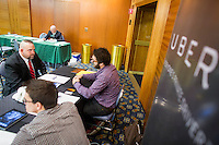 D. R. Lacy, an Army Veteran from Elmira, New York, speaks with Uber representatives who asked not to be named at the Recovering Warrior Employment Conference at the Back Bay Event Center in Boston, Massachusetts, USA. Lacy said that if Uber existed when he was younger, it would have been perfect for him, but he was at the conference looking at employment opportunities that would use his technical experience more than Uber would.<br /> <br /> The employment conference was organized by Hiring Our Heroes and Wounded Warrior Project. Hiring Our Heroes is an initiative of the US Chamber of Commerce Foundation. Approximately 40 veterans registered for the event, during which they had interviews with a number of different regional and national employers, including GE, Bank of America, Uber, and others.