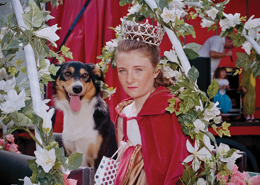 """Rose Queen of Hale, Leoni Topping with consort Denby.<br /> <br /> """"She was driven through the village in an open top classic car. Seventy children followed behind in an open top bus and Rosebuds travelled in a trailer."""""""