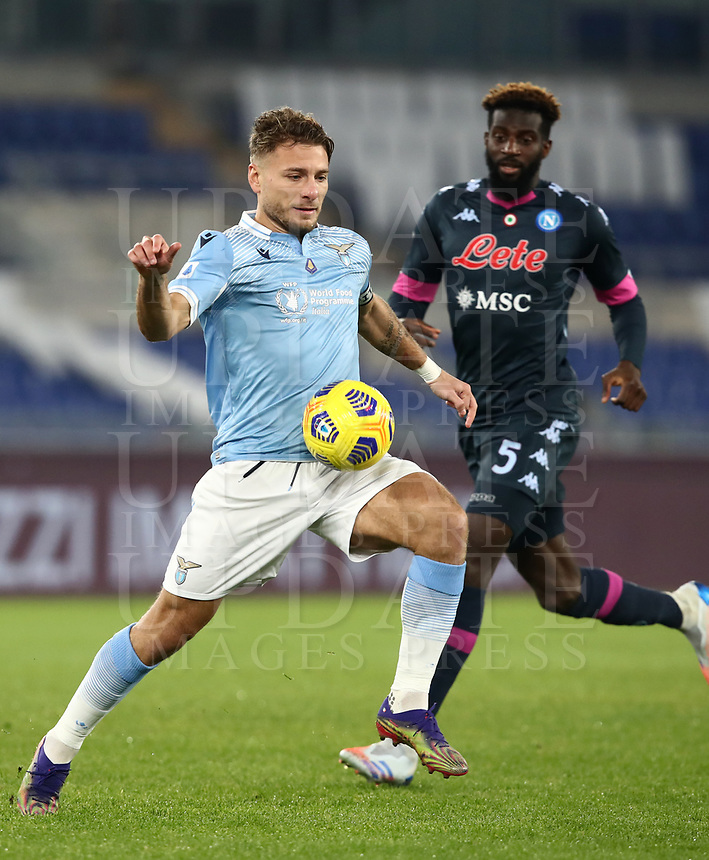 Calcio, Serie A: S.S.Lazio - Napoli, Olympic stadium, Rome, December 20, 2020. <br /> Lazio's  captain Ciro Immobile (l) in action during the Italian Serie A football match between Lazio and Napoli at the Olympic stadium, on December 20, 2020.<br /> UPDATE IMAGES PRESS/Isabella Bonotto